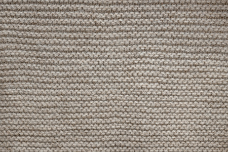 close knit: Knit texture of undyed natural brown wool knitted fabric with garter stitch pattern as background