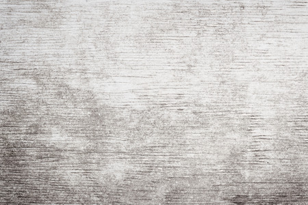 Gray wooden background of weathered distressed rustic wood with faded white paint showing woodgrain texture photo