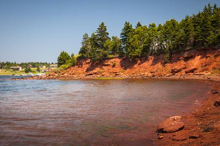 red soil: Red cliffs of Prince Edward Island Atlantic coast near Cavendish, PEI, Canada.