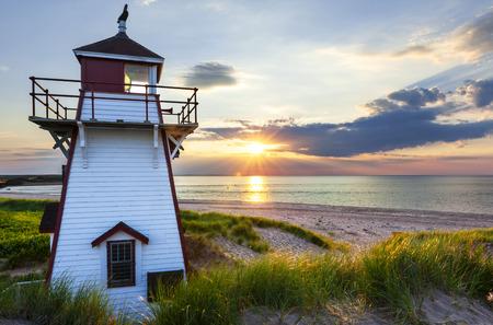 Beautiful sunset at Covehead Harbour lighthouse, Prince Edward Island, Canada photo
