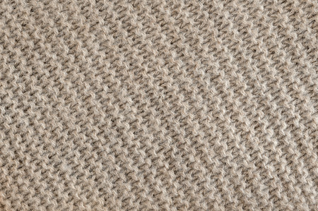 macro texture: Knit texture of undyed brown alpaca wool knitted fabric with diagonal garter stitch pattern as background Stock Photo