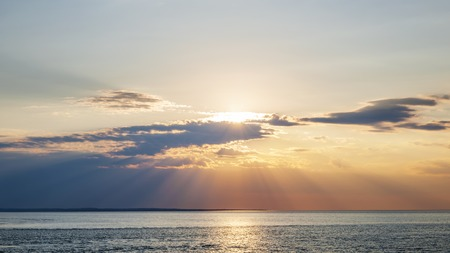 prince of peace: Sunset and sunbeams with dramatic sky over Atlantic Ocean in Prince Edward Island, Canada