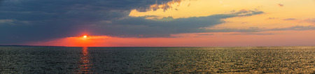 prince of peace: Panoramic sunset with dramatic  sky over Atlantic Ocean in Prince Edward Island, Canada Stock Photo