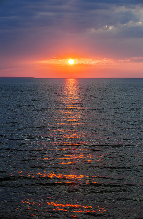 prince of peace: Setting sun with dramatic red sky over Atlantic Ocean in Prince Edward Island, Canada