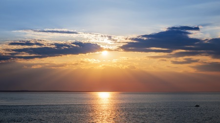 prince of peace: Sunset and sunrays with dramatic sky over Atlantic Ocean in Prince Edward Island, Canada Stock Photo