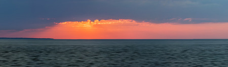prince of peace: Panoramic sunset with red dramatic  sky over Atlantic Ocean in Prince Edward Island, Canada