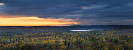 vast: Fall forest trees and sunset viewed from Lookout trail in Algonquin Provincial Park, Canada.