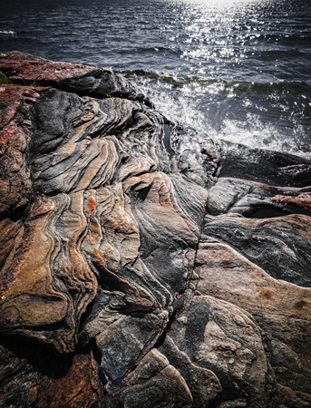 bedrock: Exposed bedrock and colorful rock formations at rugged Georgian Bay lake shore near Parry Sound, Ontario, Canada.