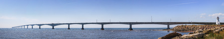 confederation: Panoramic view of Confederation Bridge with Borden-Carleton lighthouse from Prince Edward Island, Canada Stock Photo