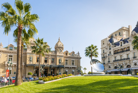 anish: MONTE CARLO, MONACO - OCTOBER 3, 2014: Monte Carlo Casino and Hotel de Paris in Monaco with Sky Mirror sculpture by Anish Kapoor in front