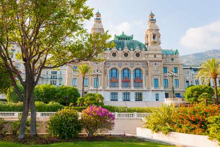 carlo: MONTE CARLO, MONACO - OCTOBER 3, 2014: Sea facing facade of Monte Carlo casino in Monaco viewed from gardens at seaside