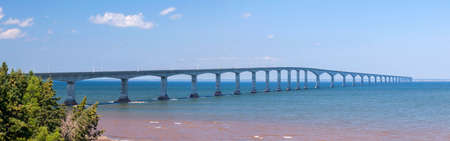 confederation: Panorama of Confederation Bridge to Prince Edward Island, view from New Brunswick coast in Canada. Stock Photo