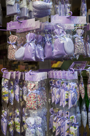 rue: NICE, FRANCE - OCTOBER 2, 2014: Lavender sachets and soaps are sold as souvenirs on Rue Pairoliere, a quaint pedestrian shopping street in old Nice.