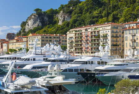 nice france: NICE, FRANCE - OCTOBER 2, 2014: Luxury yachts docked in Port of Nice, one of main harbors for the leisure boats sailing across the Mediterranean Sea. Editorial