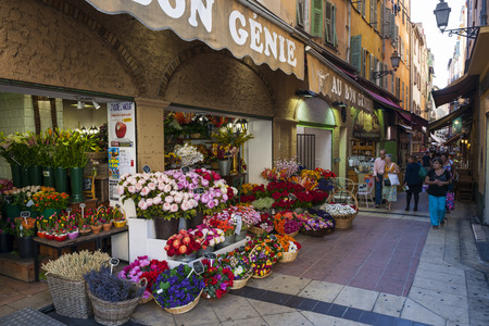 quaint: NICE, FRANCE - OCTOBER 2, 2014: Au bon genie flower shop on pedestrian Rue Pairoliere, a quaint shopping street lined with food and souvenir shops.