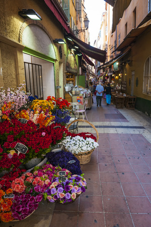 rue: NICE, FRANCE - OCTOBER 2, 2014: Walking pedestrian Rue Pairoliere, a quaint shopping street lined with food shops and cafes, is a great way to experience authentic Nice. Editorial
