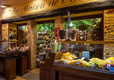 rue: NICE, FRANCE - OCTOBER 2, 2014: Gourmet food shop La Maison de lOlive on Rue Pairoliere, a quaint pedestrian shopping street in old Nice.