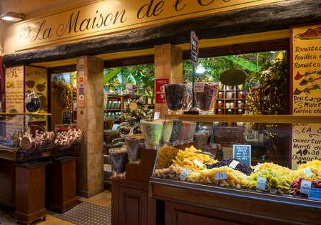 quaint: NICE, FRANCE - OCTOBER 2, 2014: Gourmet food shop La Maison de lOlive on Rue Pairoliere, a quaint pedestrian shopping street in old Nice.
