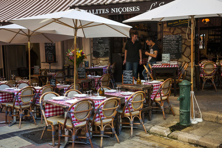 rue: NICE, FRANCE - OCTOBER 2, 2014: Outdoor patio of restaurant LEscalinada is ready for customers on Rue Pairoliere, a quaint pedestrian street in old Nice. Editorial