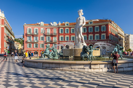 fontaine: NICE, FRANCE - OCTOBER 2, 2014: Fountain of the sun or Fontaine du Soleil with statue of Apollo at Place Massena is one of the citys many tourist attractions.