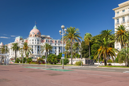 english famous: NICE, FRANCE - OCTOBER 2, 2014: View of English promenade (Promenade des Anglais) with Hotel Negresco, one of the famous landmarks of the city. Editorial