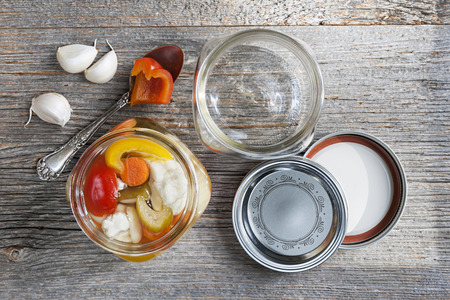 preserving: Home preserving mixed vegetables by pickling in glass canning jars
