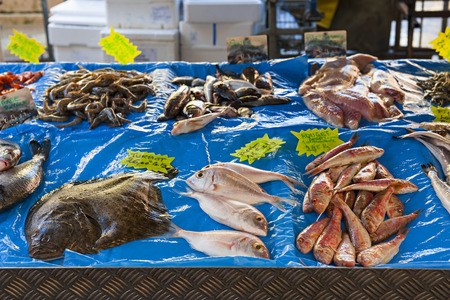 food sales: Fresh fish for sale on outdoor market in old Nice, France. Stock Photo