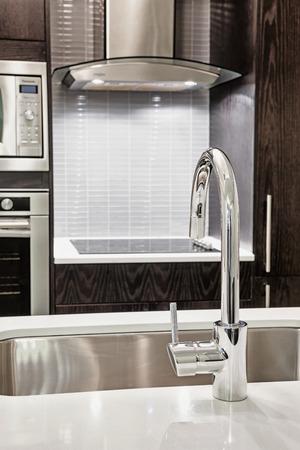 designer: Elegant faucet and sink in island counter of modern kitchen