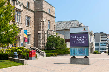 KINGSTON CANADA  AUGUST 2 2014: Welcome sign on Queens university campus next to Students Memorial Union building in Kingston Ontario Canada.