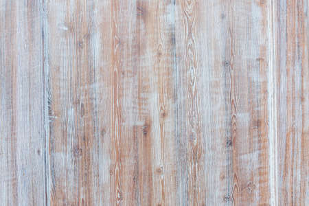 faded: Aged wooden background of weathered distressed rustic wood boards with faded light blue paint showing brown woodgrain texture