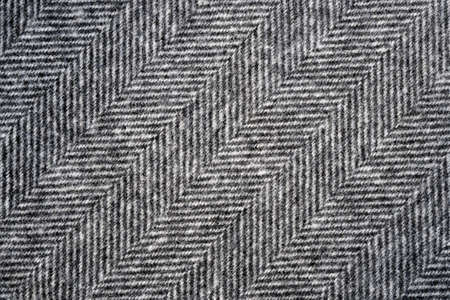 fabric pattern: Herringbone tweed background with closeup on wool fabric texture