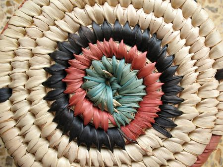Close-up of an African design on a hand-woven basket.  photo