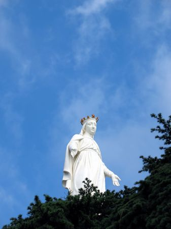 of our lady: Harissa, Our Lady of Lebanon statue against a blue sky with cedar firs in the foreground. Its a popular pilgrimage for Lebanese & tourists - Jounieh, Lebanon. Stock Photo