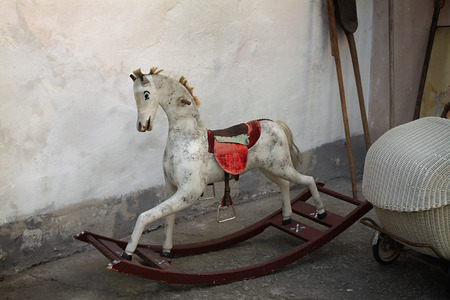 A vintage old rocking horse in a rustic setting  photo