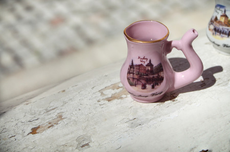 vary: A Karlovy Vary traditional porcelain jug for drinking from the natural springs.