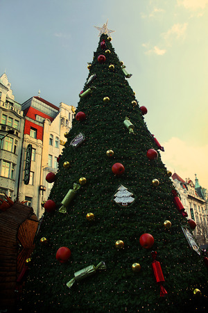 fake christmas tree: A vintage Christmas tree in Prague decorated with apples and fake candy.