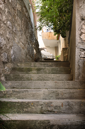 culdesac: Steps and a vintage car. Stock Photo