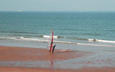 plucky: Windsurfer at the beach