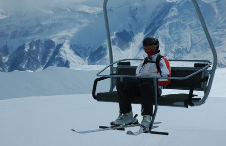 Skier on skilift at ski resort Stock Photo - 475467