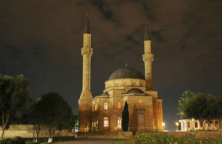 Mosque with two minarets at night in Baku, Azerbaijan