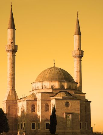 Mosque with two minarets in Baku, Azerbaijan at sunset photo