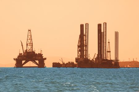 azerbaijan: Oil rig during sunset in Baku, Azerbaijan in Caspian Sea Stock Photo
