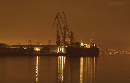 Baku port at night at dusk photo