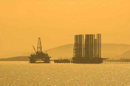 baku: Oil rig during sunset in Baku, Azerbaijan in Caspian Sea Stock Photo