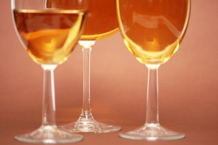Three wine glasses on the biege  background Stock Photo - 1126414