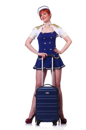 Woman travel attendant with suitcase on white Stock Photo - 21077726