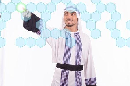 Arab businessman pressing virtual buttons Stock Photo - 21110243