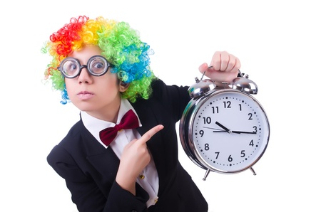 Funny clown with clock on white photo