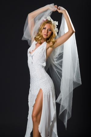 Woman in wedding dress dancing photo