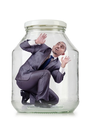 Young businessman in glass jar photo